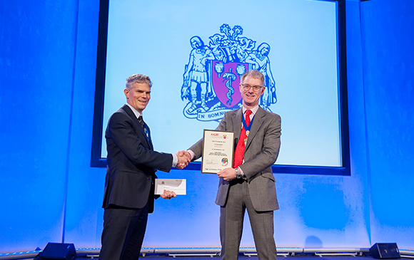 Peter Brooks receives the AAGBI innovation Award from Andrew